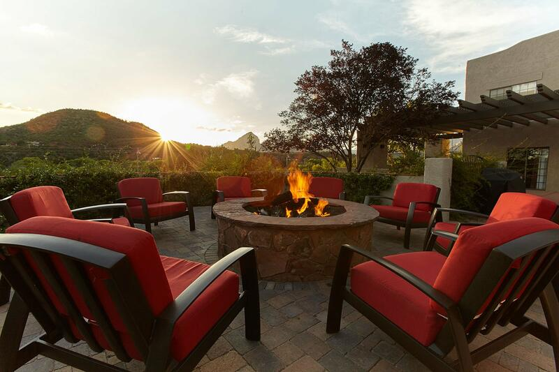 Fire pit under Arizona sunset with Red Rocks in background.