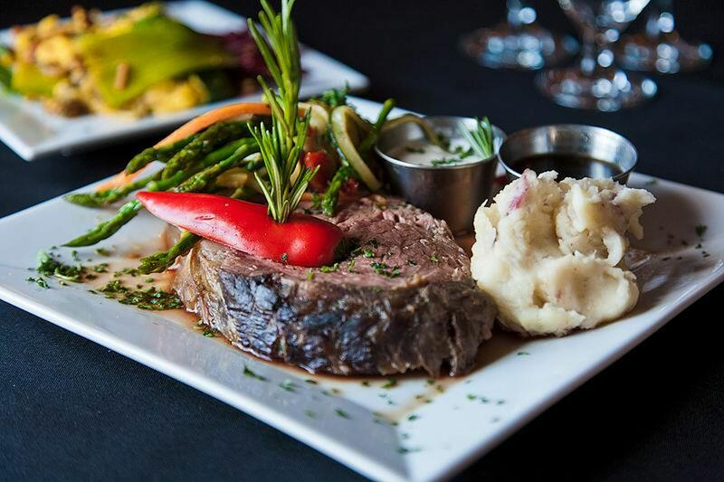 Filet with potatoes and fresh vegetables.