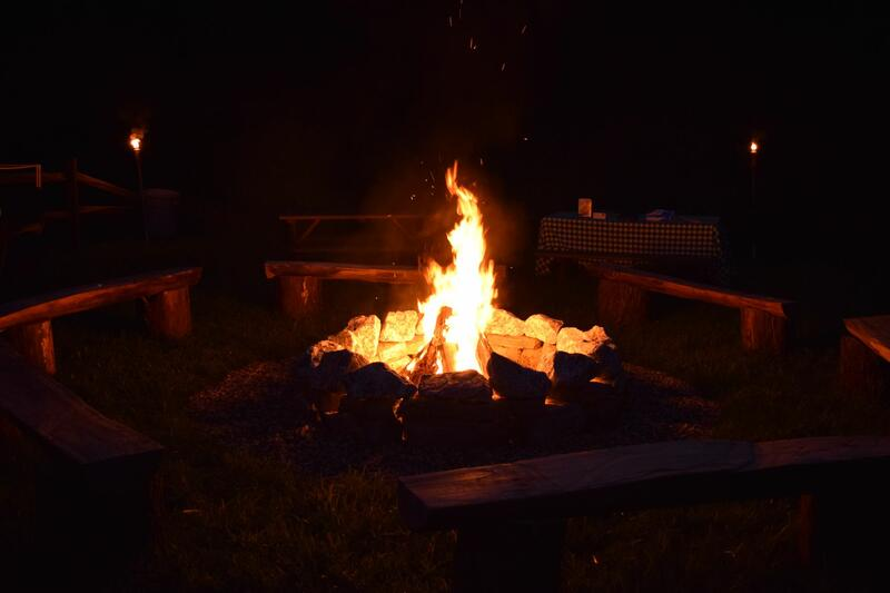 Open fire pit at night.