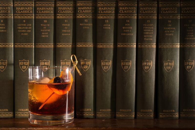 cocktail on bookshelf