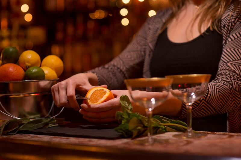 women peeling an orange