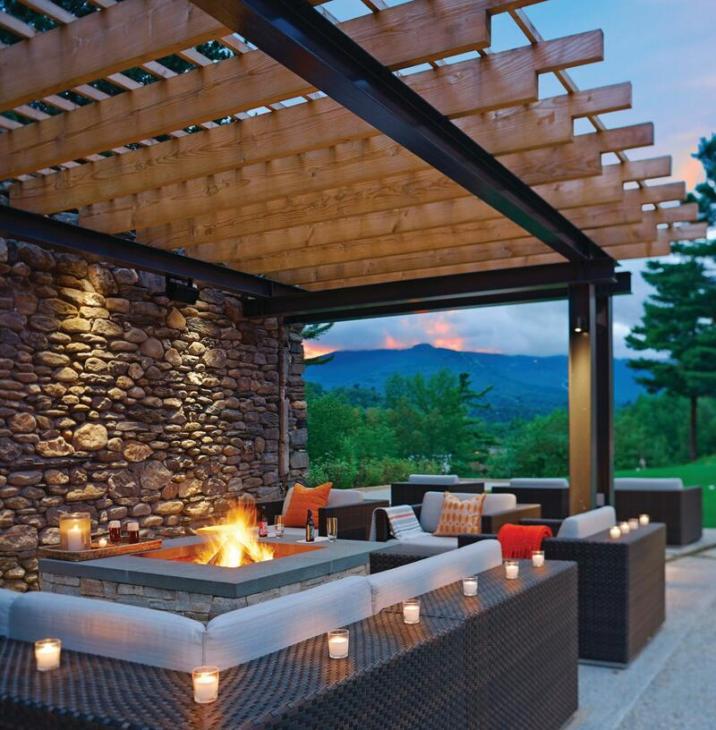 Outdoor pergola with fire pit by Vermont mountains.