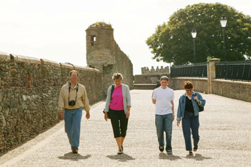 People Walking Along The Londonderry Walls