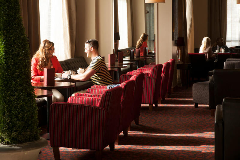 People Seated In Restaurant At City Hotel Derry