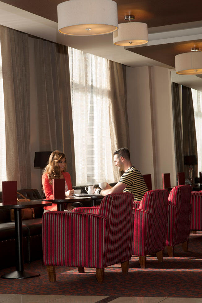 Couple Sitting At Table In Restaurant At City Hotel Derry