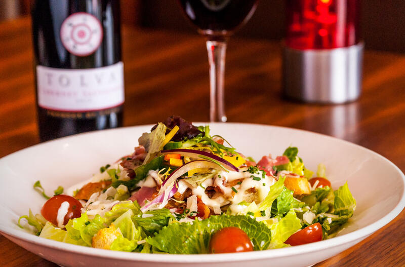 Bowl Of Salad And Wine On Table At City Hotel Derry
