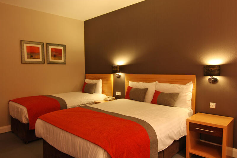 View Of Room With A Double And Single Bed At City Hotel Derry