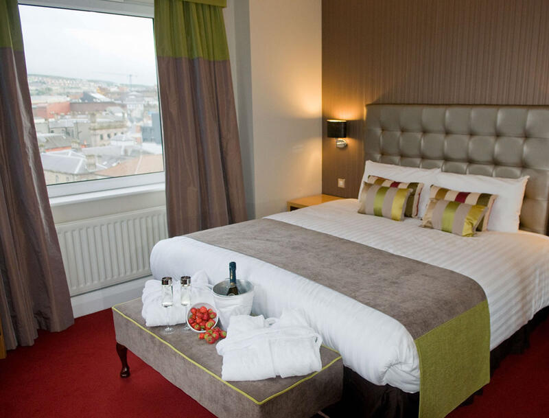 View Of Junior Suite Bedroom At City Hotel Derry