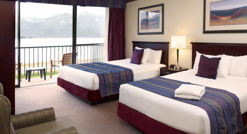 Two queen beds with lake view from balcony.