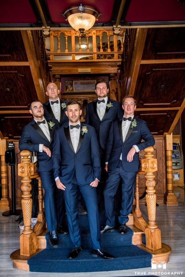 grooms party on stairs