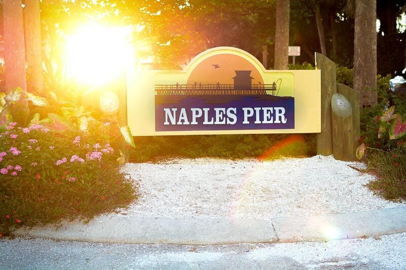Naples Pier sign.
