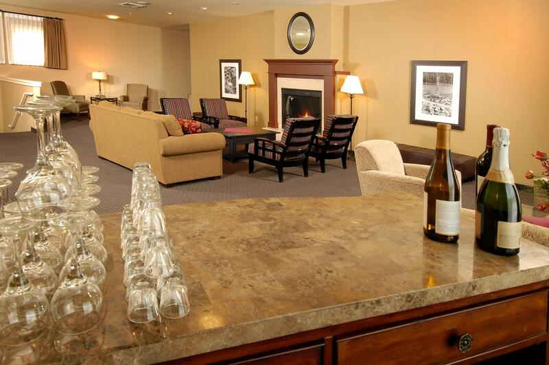 Reception room with bar and fireplace.
