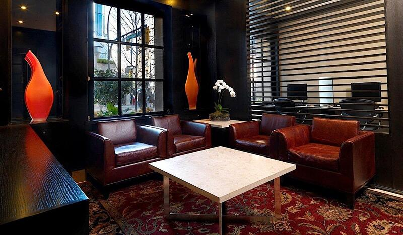 Leather chairs surrounding coffee table.