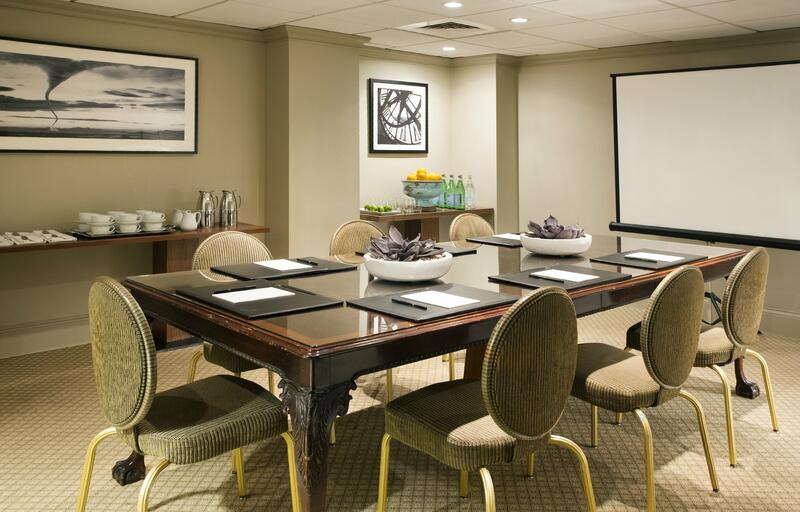 Conference room with table for 6, refreshment set in the back an