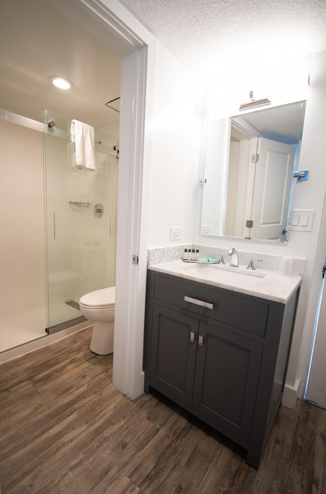 bathroom with vanity and glash shower doors
