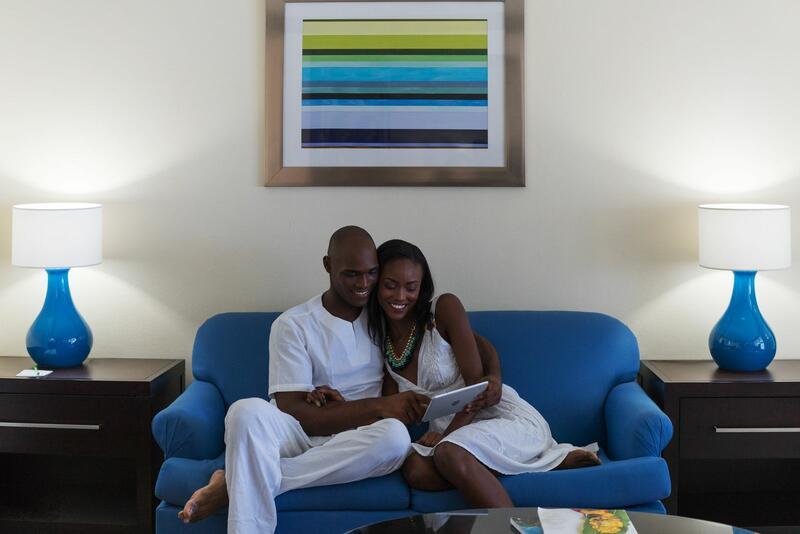 couple cuddling up on sofa