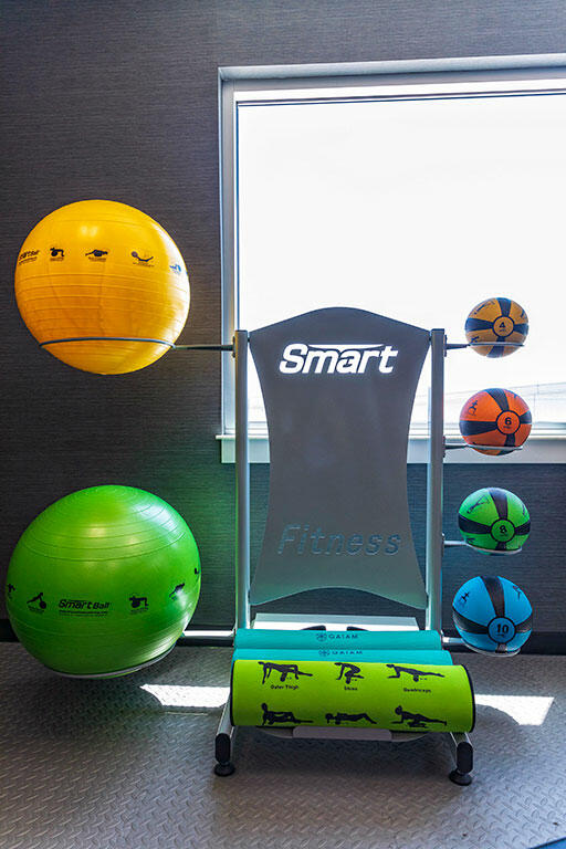 exercise balls and mats in a gym