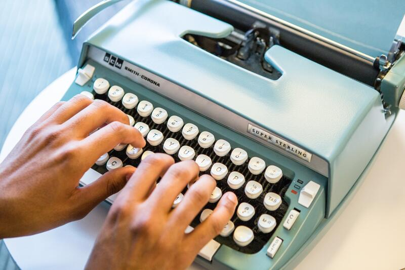 Guest typing on the in-room typewriter