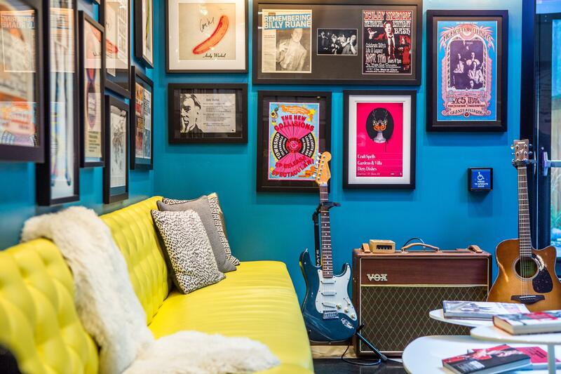 Verb Lobby with yellow couch and lots of framed music posters