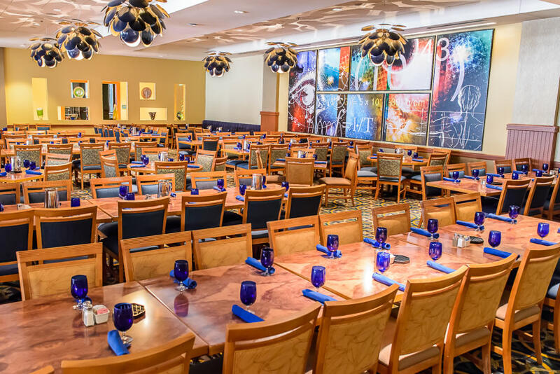 tables set next to each other with blue place settings