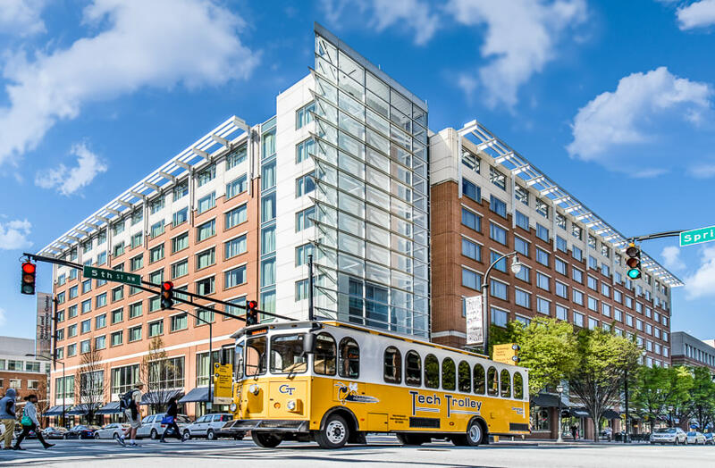 bus passing the exterior of Georgia Tech Hotel and Conference Ce