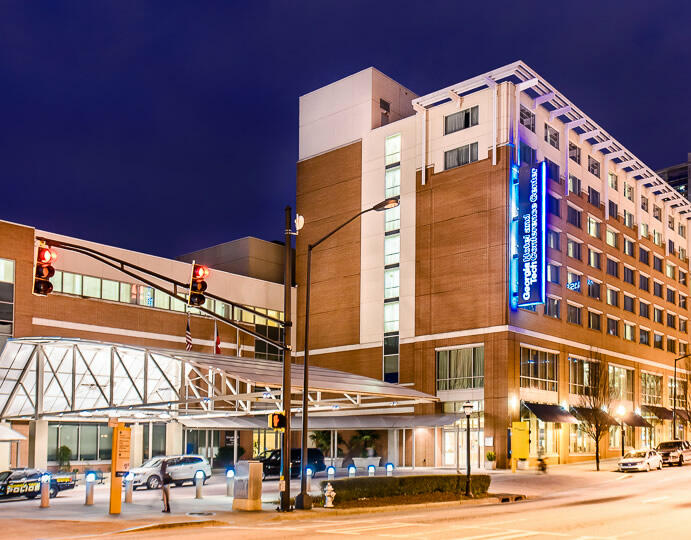 exterior of Georgia Tech Hotel and Conference Center at night