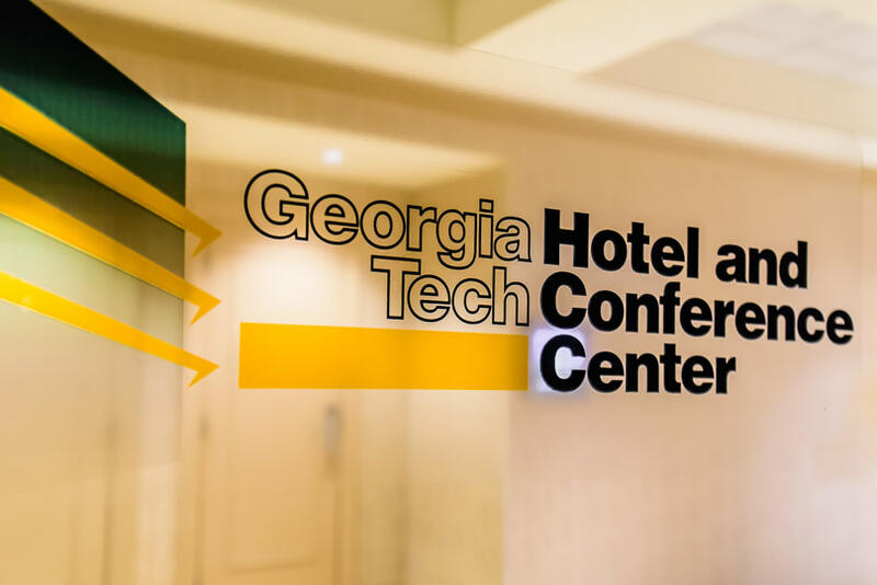 Georgia Tech Hotel and Conference Center logo on glass window