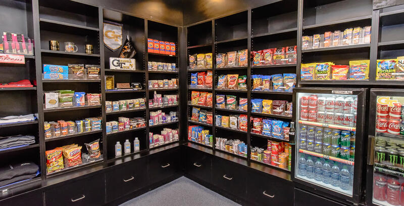 assorted snacks on rows of shelves