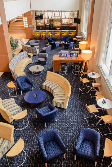 small sofas and chairs with coffee tables in lobby