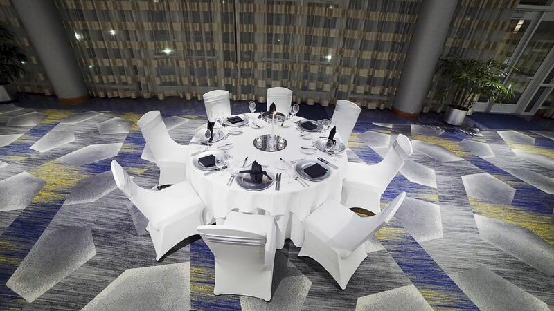 white table set for 8 with silver place settings