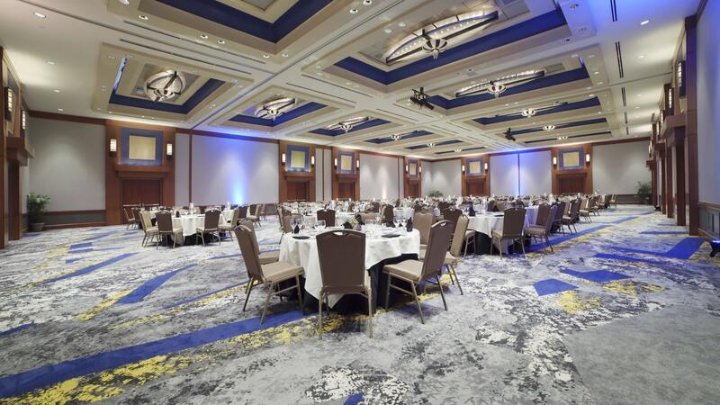 large banquet hall with many circular tables set