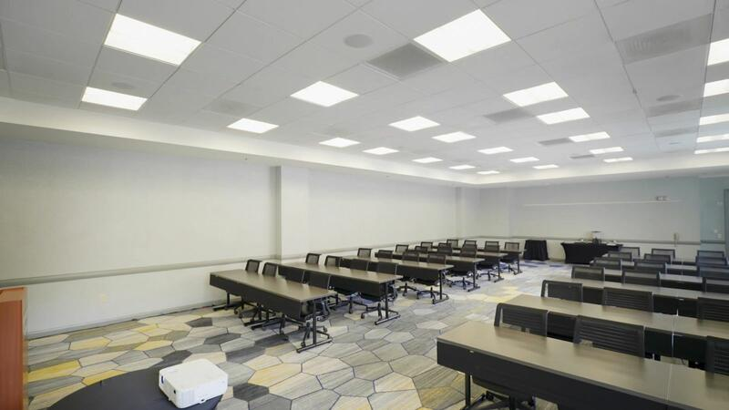 conference room with long tables and desk chairs