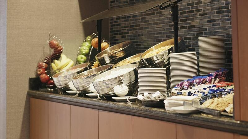 side bar with buffet, fruit and plates