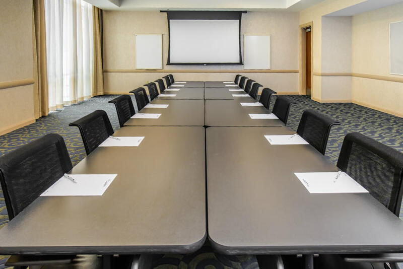 conference room with tables forming larger table and desk chairs