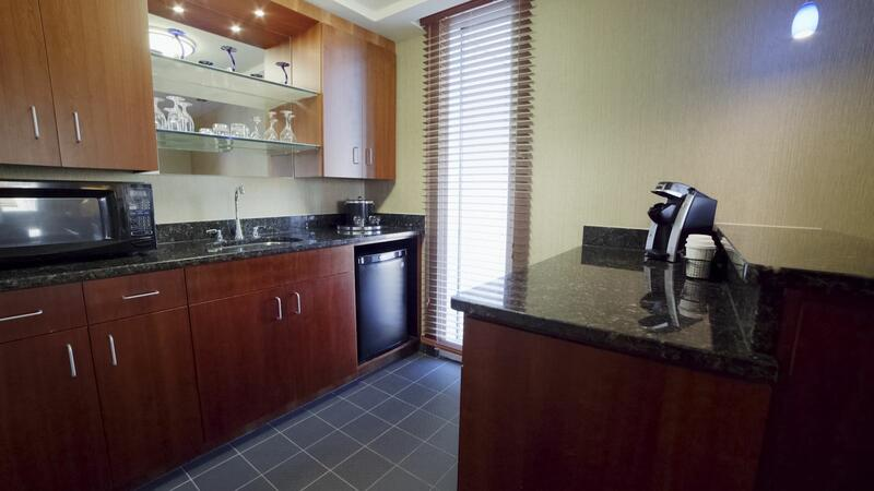 small kitchenette with microwave, coffee machine and dishwasher