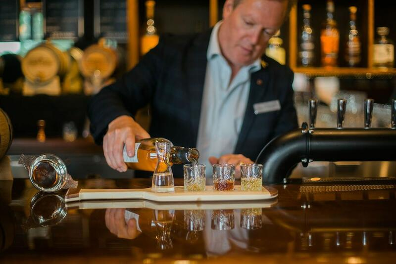 Gentleman pouring flight of cocktails.