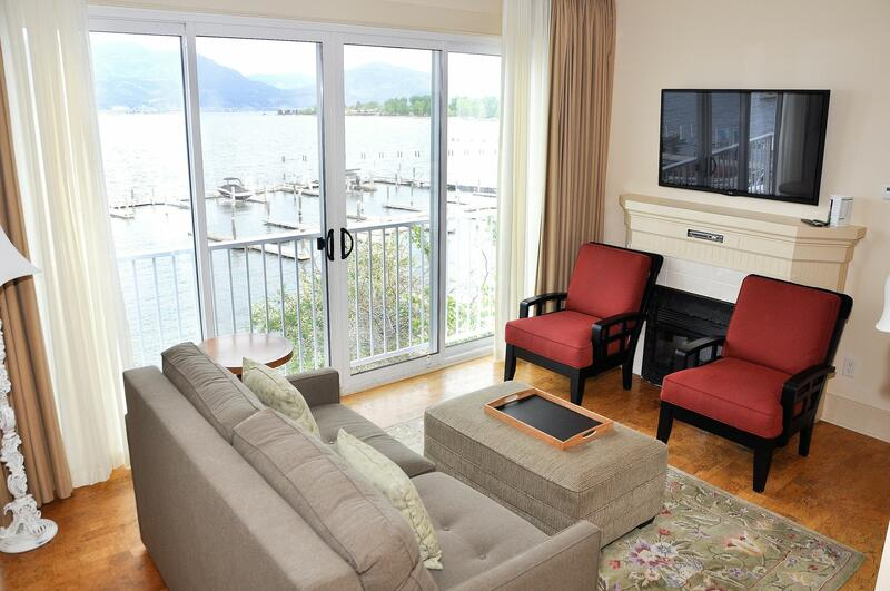 Hotel room living space with lake view.