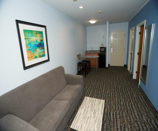 Couch and small kitchen area in Efficiency Room