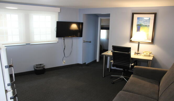 Couch and TV in Efficiency Room