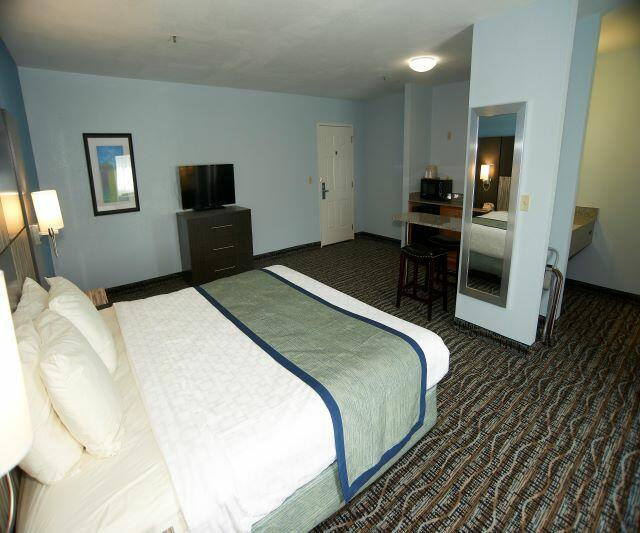 King Bed and Mirror in Deluxe Room
