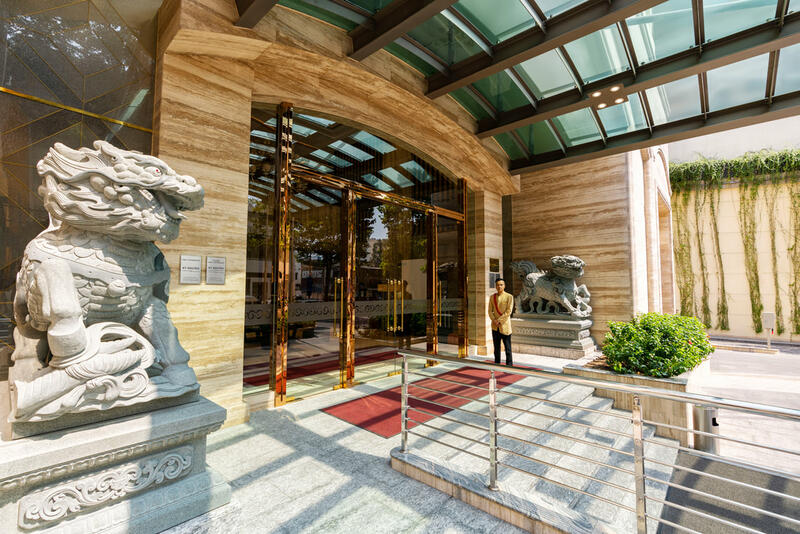 Sherwood Suites Saigon's Entrance with two stone guardian lion