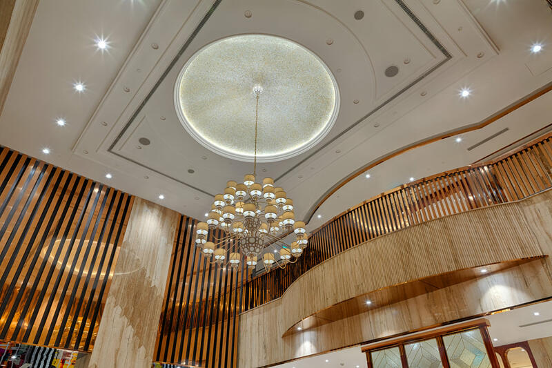Luxurious hotel lobby with grand chandelier