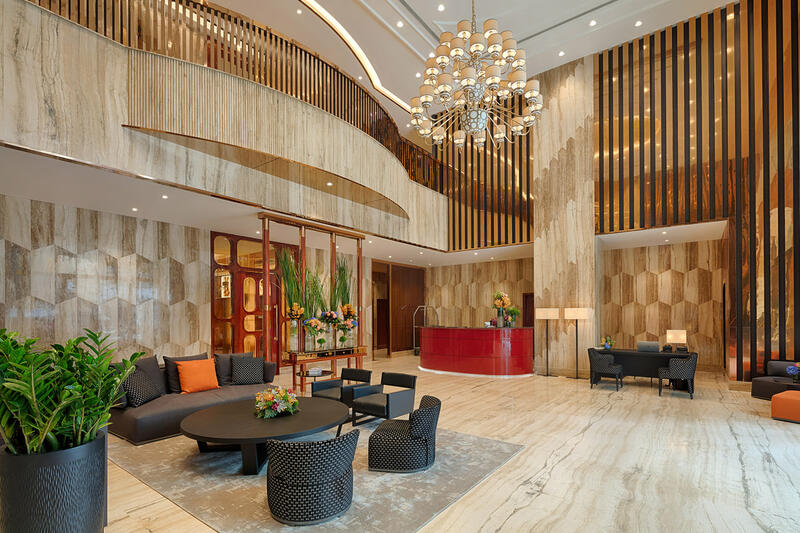 luxurious hotel lobby with sitting area and reception desks