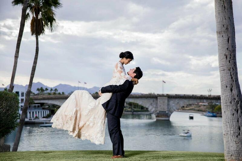 Groom picking up his smilling bride near Lake Havasu.