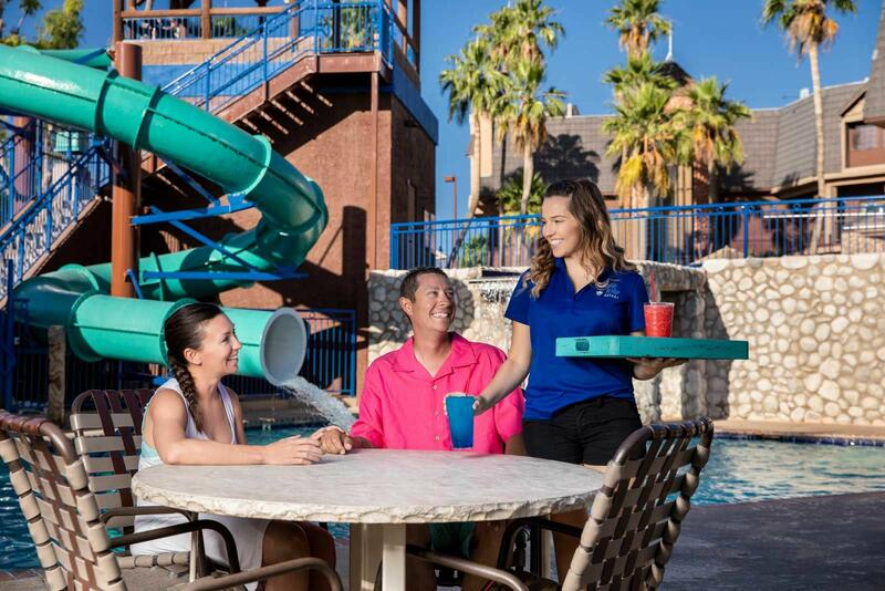 Family getting drinks by the water slide.