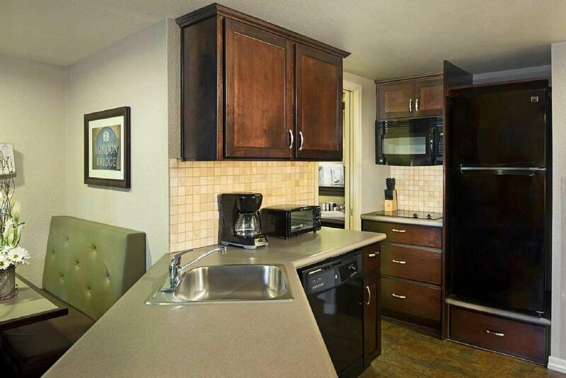 Expansive resort suite kitchenette with bar and table.