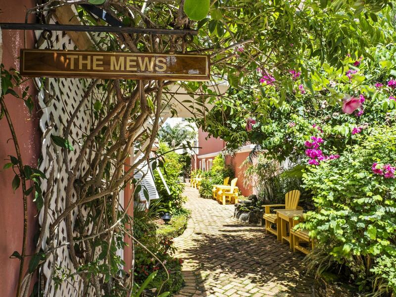 garden with pathway and sign that says The Mews