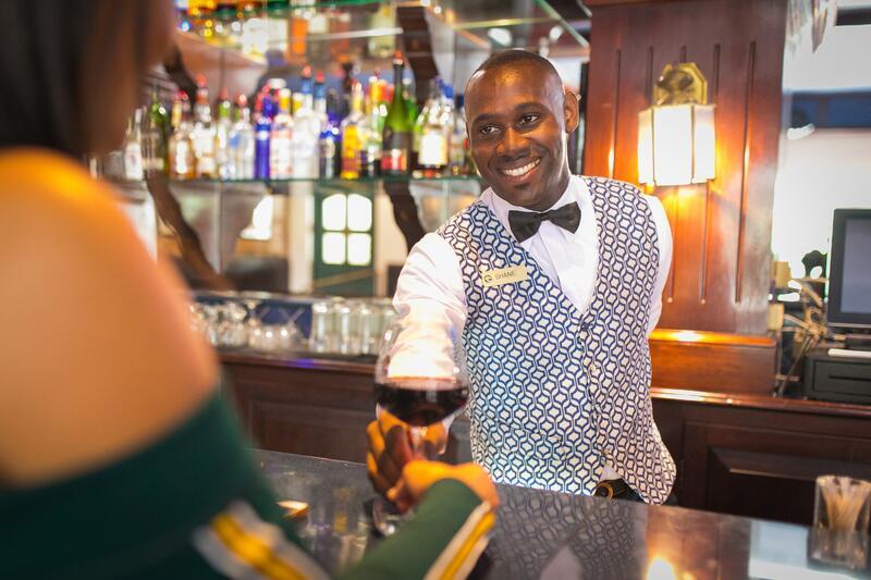 Man serving wine at bar