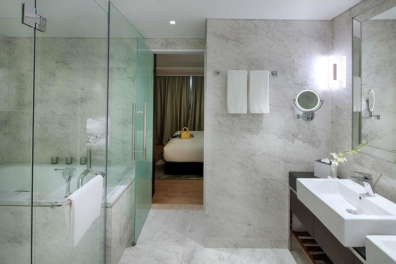 hotel bathroom with  marble finishing and double sink