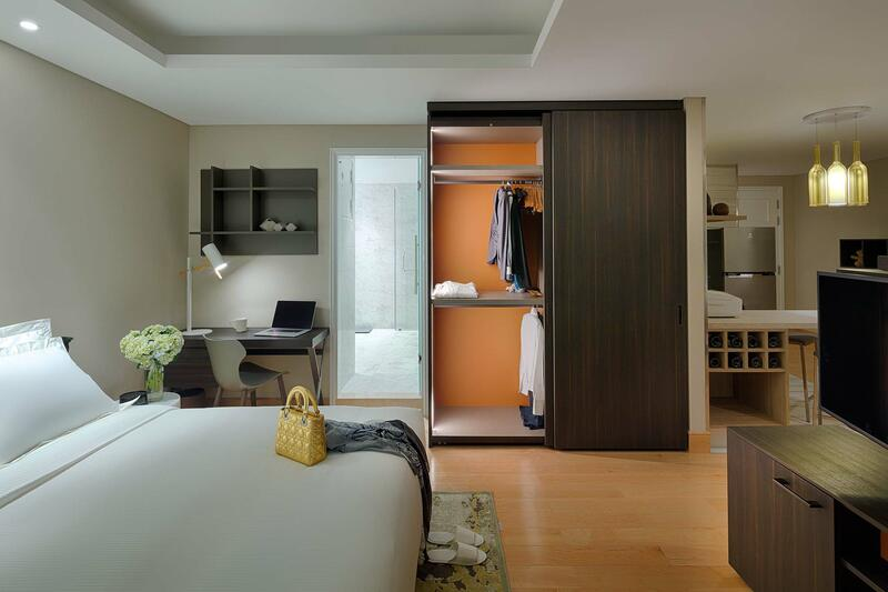 expansive bedroom with king bed and wardrobe
